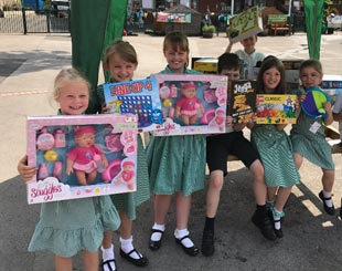 Children with gifts at Cale Green Primary School